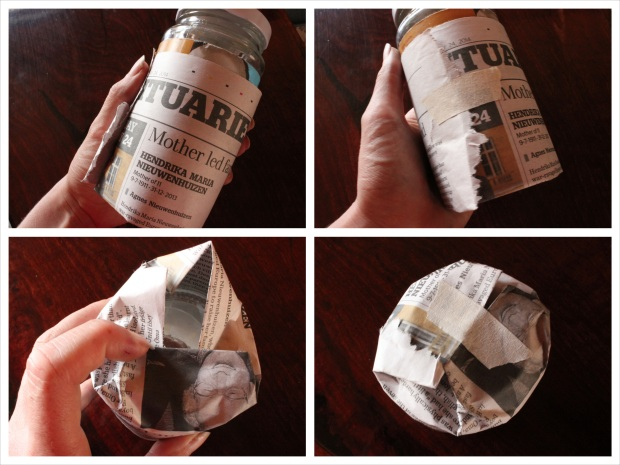Wrap the folded quarter of newspaper around a jar (open ends up), tape it in place, then fold the bottom in and tape that in place.